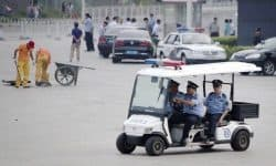 police golf cart on China street